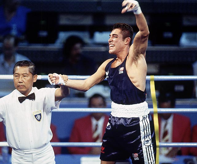 "Shortly before she succumbed to breast cancer, Cecilia Gonzalez De La Hoya received a promise from her son, Oscar, that he would one day bring home an Olympic gold medal in boxing. Cecilia died in 1990, but in 1992, Oscar fulfilled his promise. De La Hoya defeated Germany's Marco Rudolph 7-2 to win the gold, the U.S.'s only boxing gold at the 1992 Games. ""It was all over so fast. I feel like I waited for this moment all my life,"" he said after the victory."