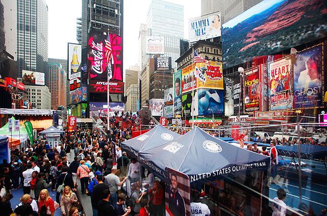 Olympians past and present, celebrities and New York bystanders enjoyed the festivities in Times Square.