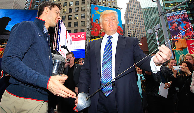 Donald Trump inspects a fencing foil next to Olympian Tim Morehouse.