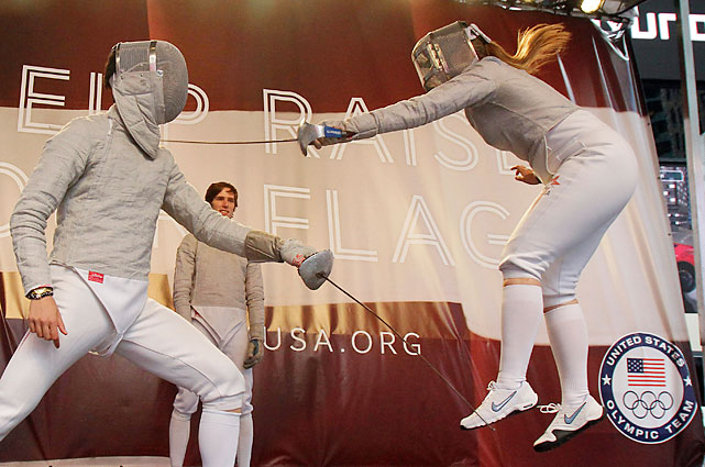 Fencers James Williams (left) and Dagmara Wozniak duel. The 16-member U.S. fencing team is set for the London Games.