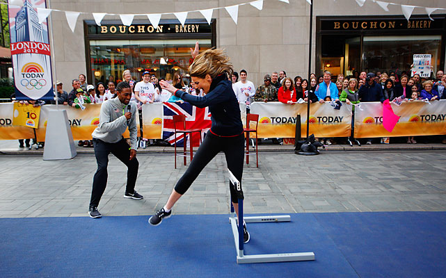 The Today Show 's Natalie Morales attempts to clear a hurdle as Jason Richardson looks on. Richardson, 26, was the surprise world champion in the 110-meter hurdles in 2011.