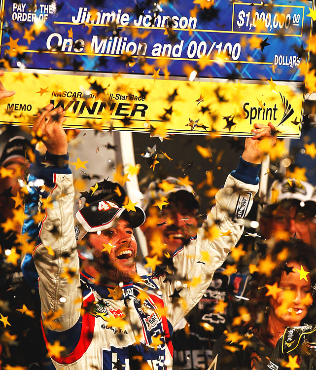 Johnson holds up his winners' check as confetti pours down in Victory Lane. All told, he earned $1,071,340 on the night.