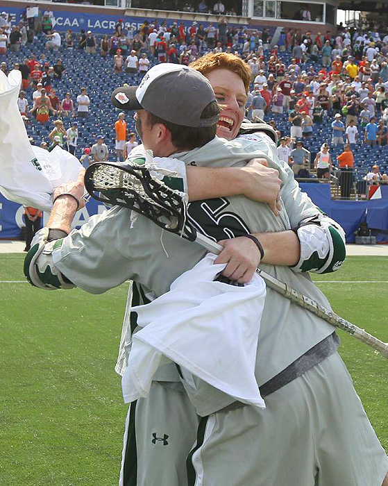 Senior Pat Burns hugs his teammate after the game.
