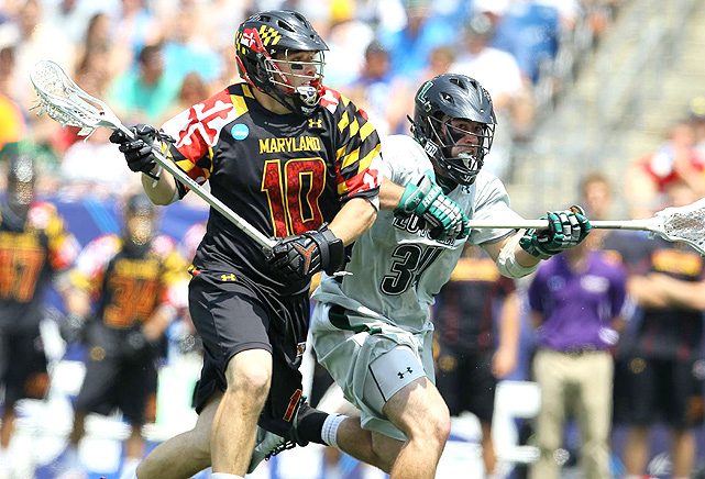 Maryland's Michael Shakespeare and Loyola's Pat Laconi battle for field position.