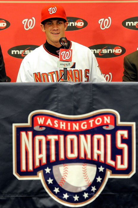 Harper speaks to the media after signing his first contract with the Nationals.
