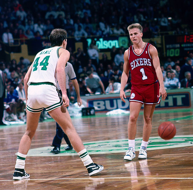 During a 1989 regular season game at the Boston Garden, Scott Brooks looks for an opening against Danny Ainge. Brooks spent two years in Philadelphia averaging just less than 5.0 points and just over 3.3 assists per game.