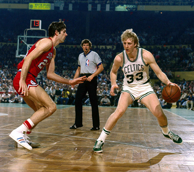 Bobby Jones defends Larry Bird in a 1980 regular season game at the Boston Garden. Bird was crowned the league's Most Valuable Player three times and made 12 All-Star game appearances.