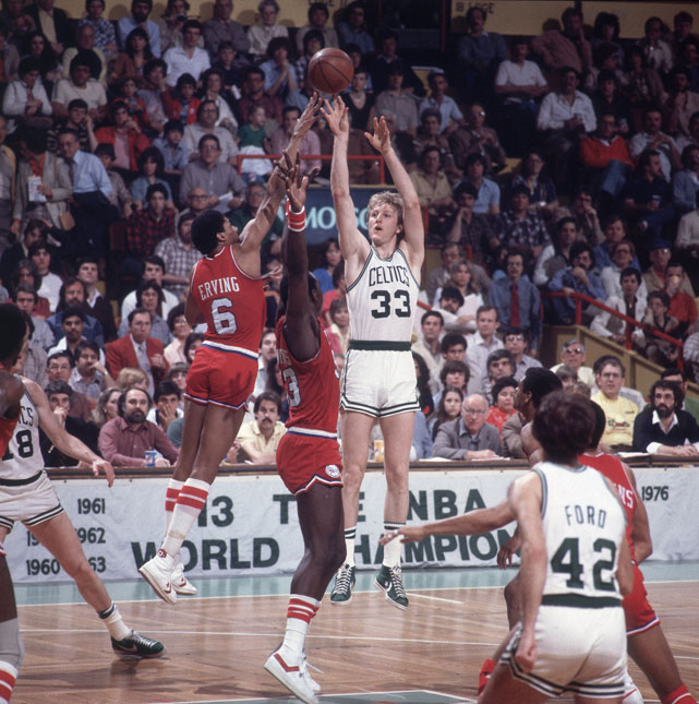 Larry Bird arcs a shot over the outstretched hands of Julius Erving and Darryl Dawkins.