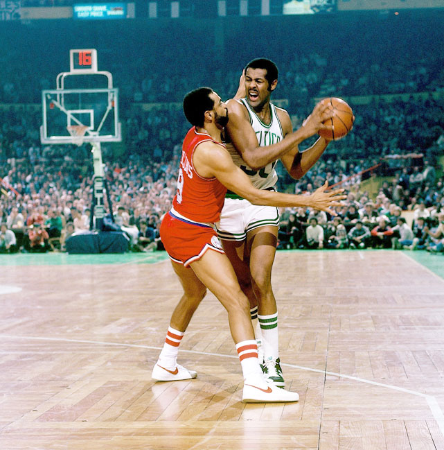 M.L. Carr tries to find air against the suffocating defense of Lionel Hollins. Carr won two titles with the Celtics in 1981 and 1984.