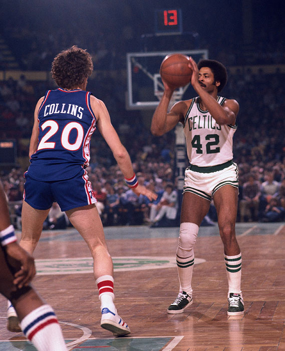 Don Chaney pulls up for a shot against Doug Collins during a 1975 regular season game played in Boston.  During his time with the Celtics, Chaney won two NBA titles, the first one coming in 1969 and the second coming seven years later.