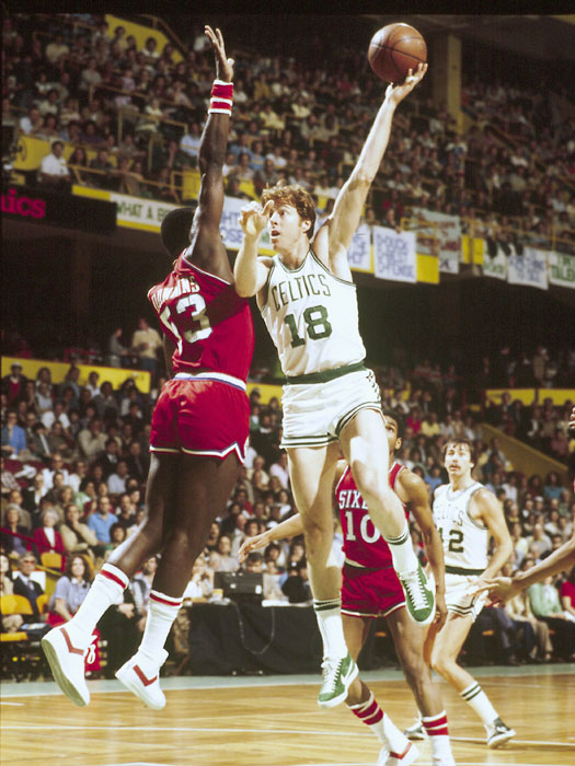 Dave Cowens attempts a shot over Darryl Dawkins. Cowens' decorated career is highlighted by two NBA titles with the Boston Celtics in 1974 and 1976 and the NBA's MVP Award in 1973.