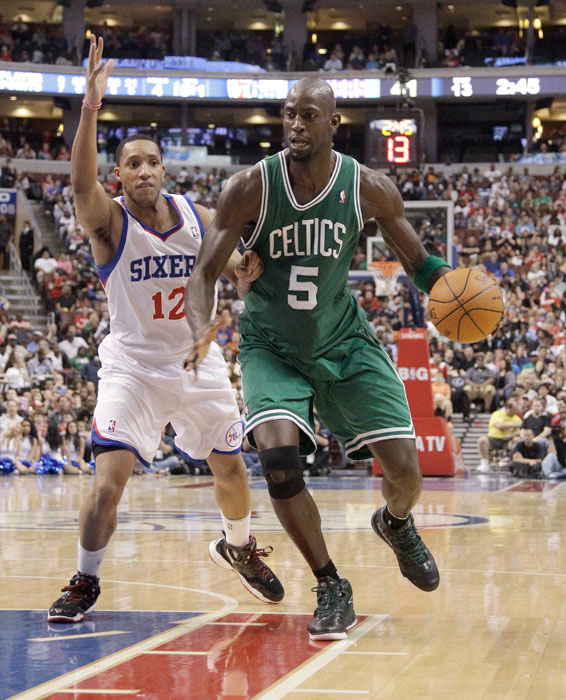 Kevin Garnett drives past Evan Turner #12 during a regular season game in March  2012.  Garnett finished the game with 20 points and 8 rebounds as the Celtics fell to the 76ers, 99-96.
