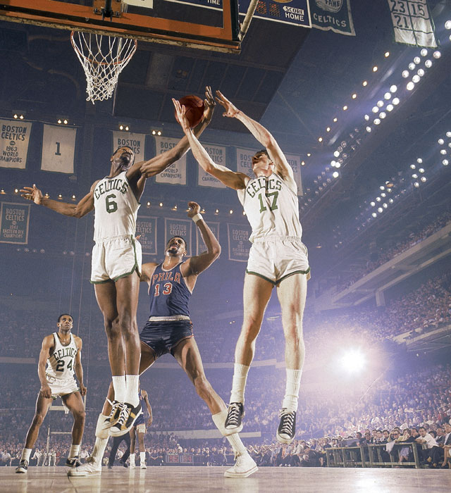 In the 1967 NBA Playoffs, Bill Russell and John Havlicek contest a rebound with  Wilt Chamberlain at the Boston Garden.  Havlicek and Russell would go on to win the NBA Championship the following year as the Celtics captured the 10th title in franchise history.