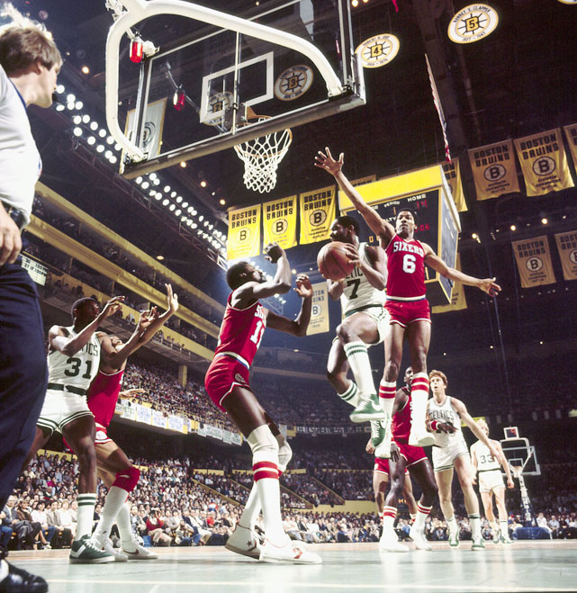 "Nate ""Tiny"" Archibald tries to cut past Julius Erving on his way to the basket. Archibald was a six-time NBA All-Star and won his only career Championship with the Celtics in 1981."