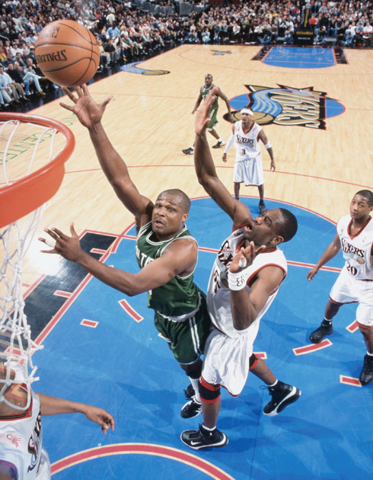 Antoine Walker drives to the basket against Dikembe Mutombo during a March 2002 game. Walker's scoring prowess earned him three NBA All-Star appearances.