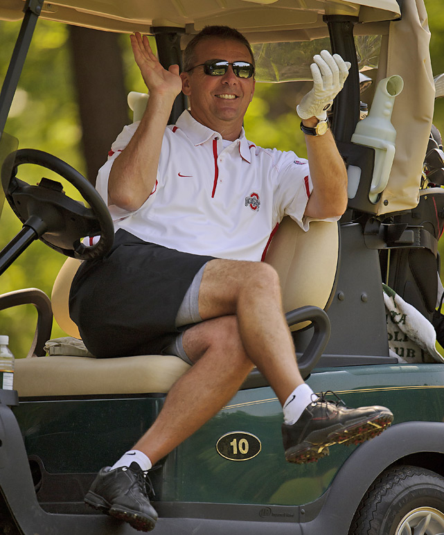 Ohio State's Urban Meyer reacts to a shot by his teammate Jeff Logan.