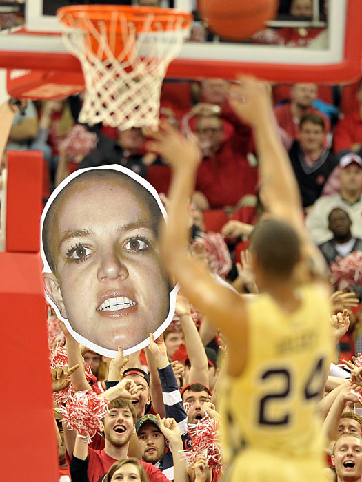 NC State fans distract a Georgia Tech free throw shooter with an image of a bald Britney Spears.