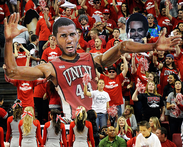 Not satisfied with just a giant head, UNLV fans go the extra mile to give star forward Mike Moser a body with flexible arms.
