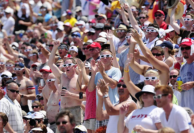 Fans wearing white sunglasses to honor 2011 Indy 500 champion Dan Wheldon.