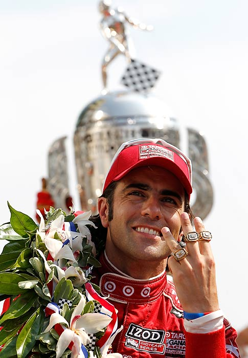Dario Franchitti celebrates winning his third Indy 500.