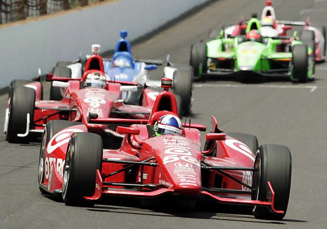 Dario Franchitti leads teammate Scott Dixon and Takuma Sato of Japan into the first turn.