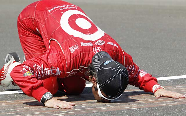 Franchitti kisses the start/finish line after becoming the seventh driver to win three Indy 500s.