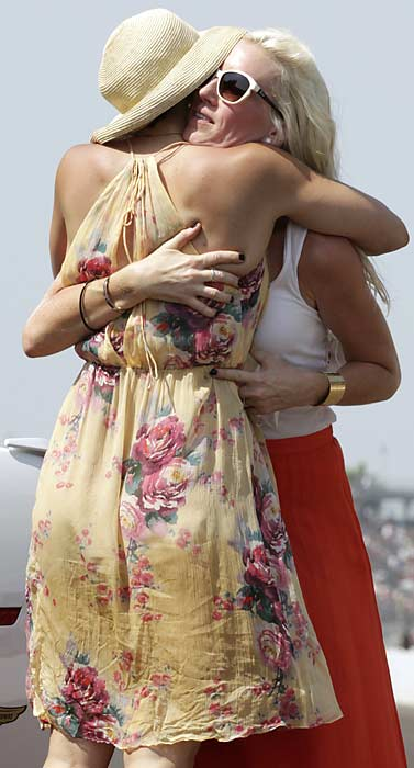 Franchitti's wife, Ashley Judd, got a congratulations hug from Susie Wheldon, whose late husband won last year's 500.