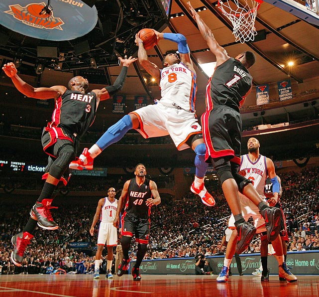J.R. Smith of the New York Knicks goes up for a shot against the Miami Heat's Chris Bosh in Game 4 of the Eastern Conference quarterfinals.