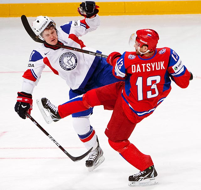 Norway's Alexander Bonsaksen takes a stick in the neck from Russia's Pavel Datsyuk during a preliminary round match at the Ice Hockey World Championships in Stockholm on May 6.