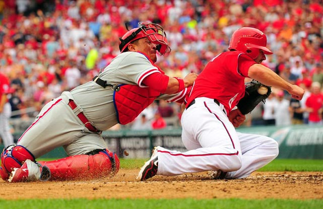 Philadelphia Phillies catcher Carlos Ruiz puts the tag on Washington Nationals second baseman Danny Espinoza.