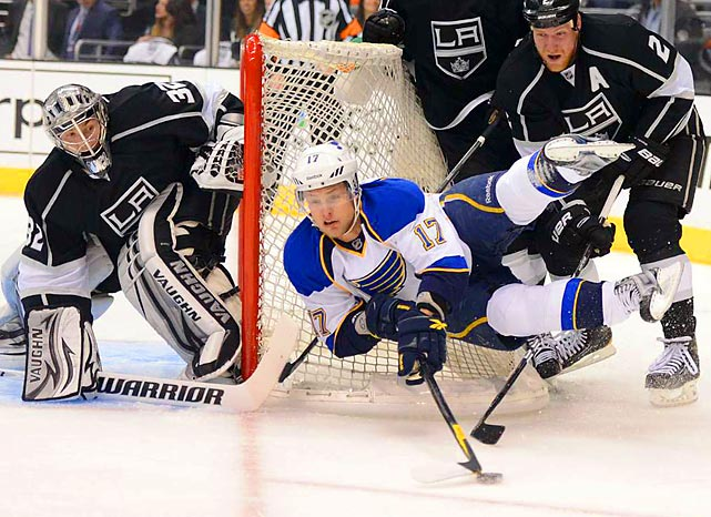 St. Louis Blues forward Vladimir Sobotka flies off the ice, without taking his eyes off the puck, while trying to score. However, Sobotka's efforts ultimately proved fruitless, and the Kings swept the Blues in the playoffs.