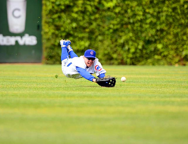 Chicago Cubs center fielder Tony Campana dives for a ball during a game against the Los Angeles Dodgers.