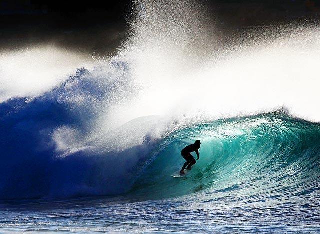 A surfer rides a nearly-perfect wave at Bronte Beach in Sydney, Australia.