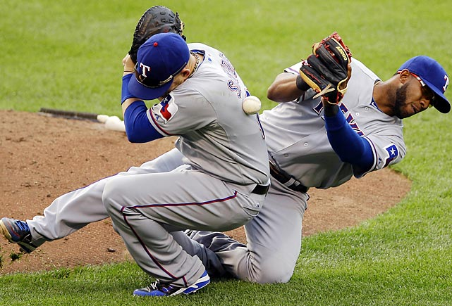 Texas Rangers first baseman Brandon Snyder, left, and shortstop Elvis Andrus collide as they drop a pop fly by Baltimore Orioles' Robert Andino.