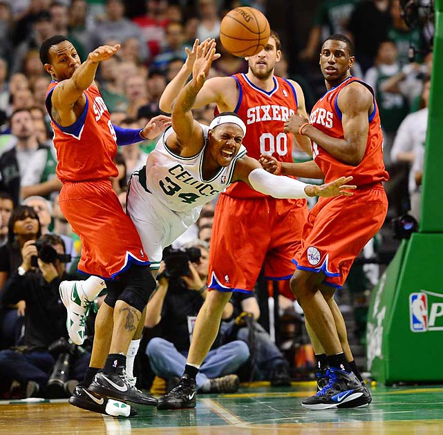 Paul Pierce dives through a group of 76ers defenders during the first game of their second-round playoff series.