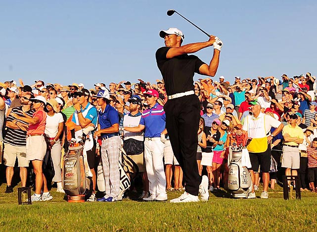 Tiger Woods tees off at the 18th hole during The Players Championship at Ponte Vedra Beach, Fla.