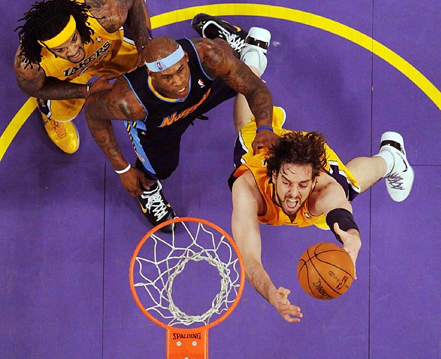 Pau Gasol of the Lakers drives to the basket during the playoff series against the Nuggets. The Lakers won in seven games.