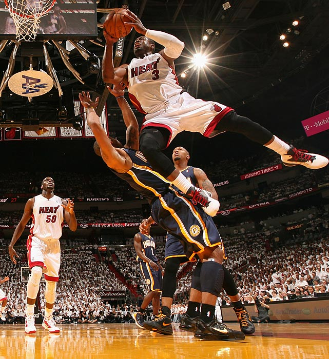 Miami Heat's Dwyane Wade drives hard to the basket against Dahntay Jones  of Indiana in Game 2 of their Eastern Conference semifinal during the NBA playoffs.
