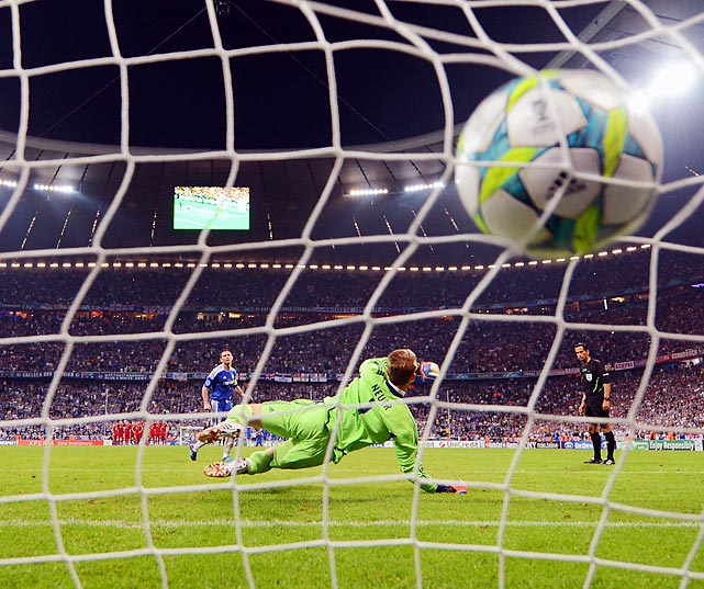 Chelsea's Frank Lampard fires his penalty kick past Bayern Munich goalkeeper Manuel Neuer during the UEFA Champions League Final. Chelsea won in penalty kicks, 1-1, 4-3.