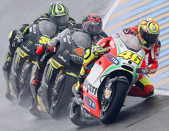 Ducati MotoGP rider Valentino Rossi of Italy rides ahead of Yamaha MotoGP rider Andrea Dovizioso of Italy (center) and Yamaha MotoGP rider Cal Crutchlow of Britain (back) during the MotoGP French motorcycling Grand Prix. Rossi finished second behind Yamaha MotoGP rider Jorge Lorenzo of Spain.