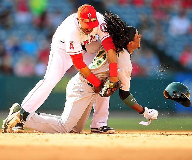 Jemile Weeks of the Oakland As collides with Angels infielder Erick Aybar while stealing second.