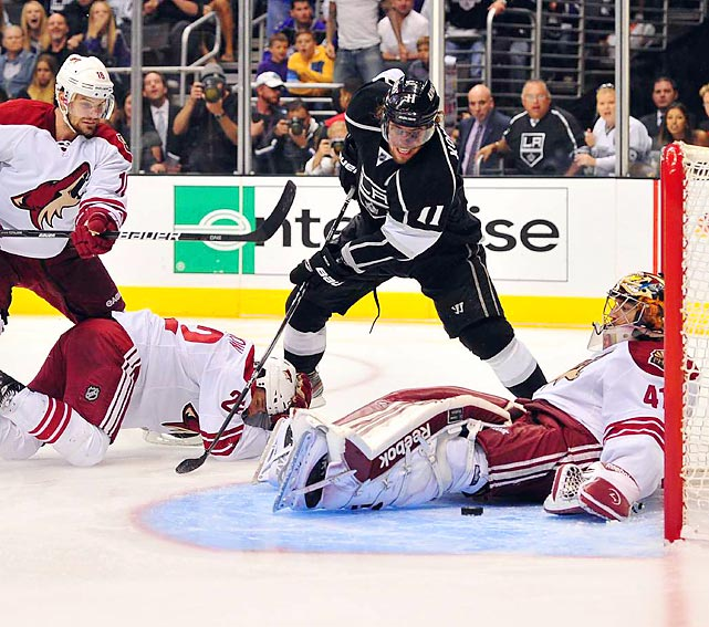 Anze Kopitar of the Los Angeles Kings stands over Phoenix goalie Mike Smith looking to make a shot during Game 4 of the Western Conference Final.