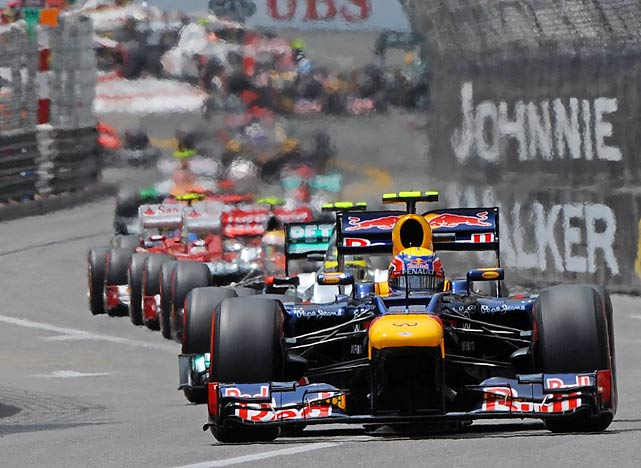 A line of cars snakes through the Monaco Grand Prix circuit.