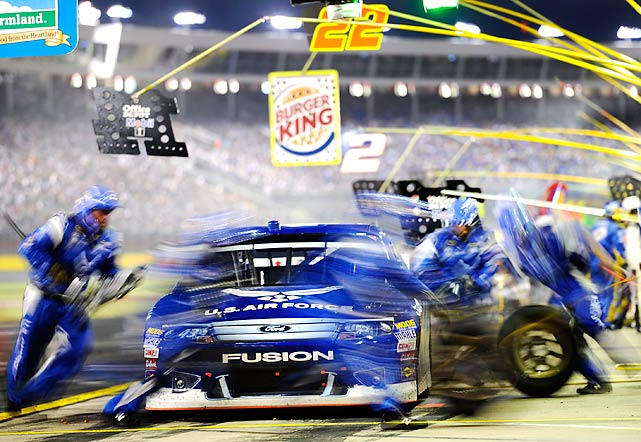 Aric Almirola's pit crew moves so quickly that they're just a blur during the Coca-Cola 600 at Charlotte Motor Speedway.