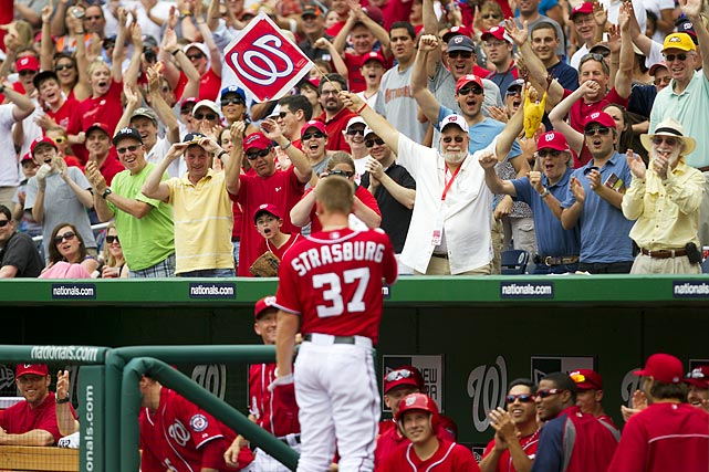 After dusting off his home run trot and returning to the dugout, Strasburg responded to a curtain call by waving to the crowd of 41,918.
