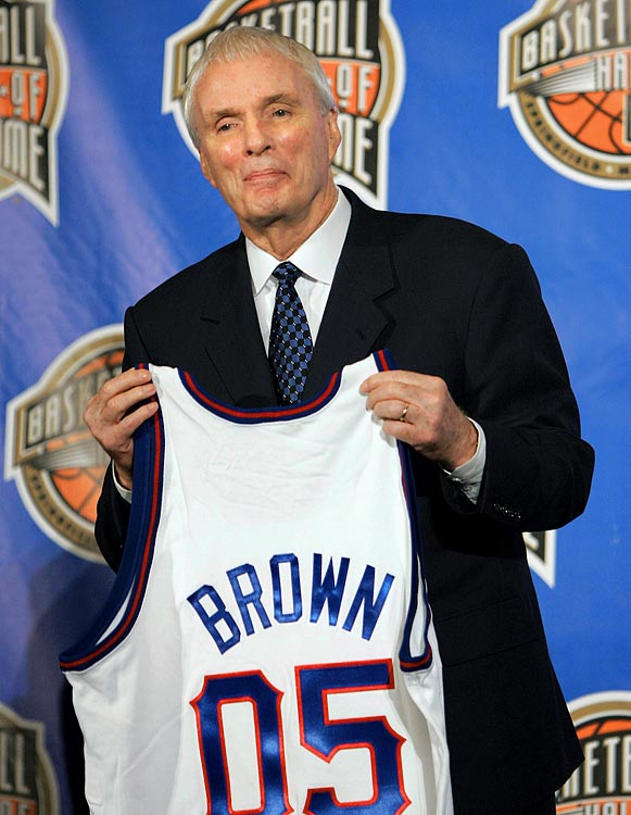 Brown holds a jersey during a press conference naming him to the Basketball Hall of Fame in April 2005.