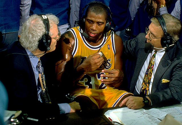 Magic Johnson speaks with then TNT commentators Brown and Verne Lundquist after a game against the Warriors in Jan. 1996. It was Johnson's first game back from his retirement.