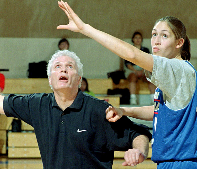 Brown gives box-out instruction to WNBA player Rebecca Lobo during a clinic in Orlando in 1998.