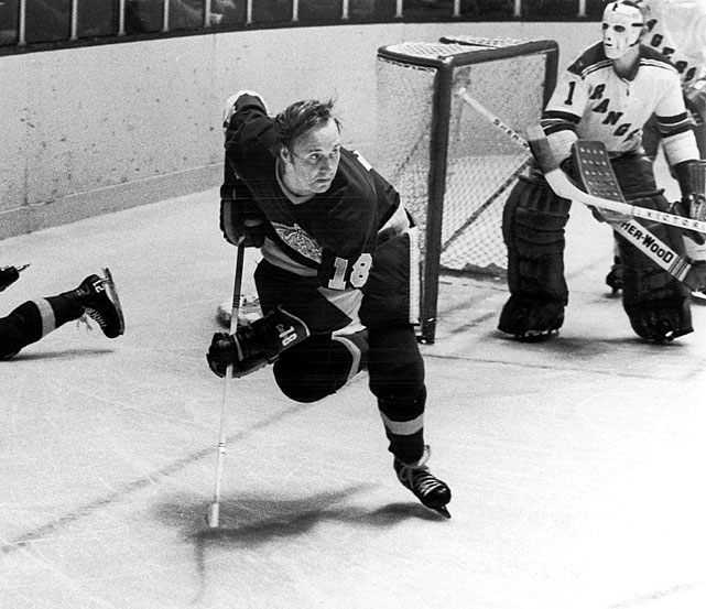 "Arriving in LA in 1970 after the Canadiens sold his rights to the Kings, Berry had a stellar breakout rookie campaign that saw him score 63 points in 73 games. He played six more seasons, scoring 350 points in 541 games and making two All-Star Game appearances for the Kings. A member of ""the Hot Line"" with center Juha Widing and right wing Mike Corrigan, Berry went on to coach the team from 1978 to 1981."