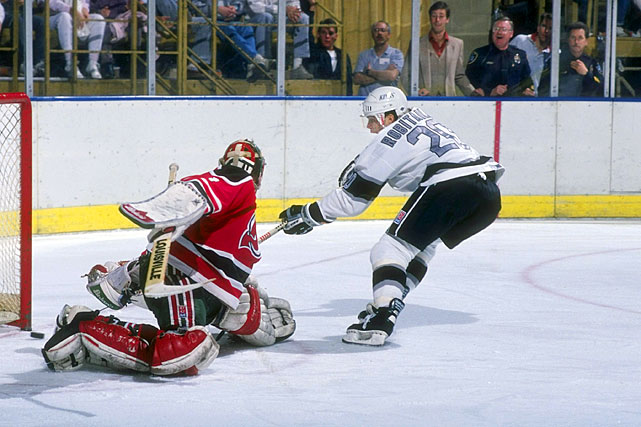"""Lucky Luc"" was beloved by Kings fans during his 14 seasons in LA. Chosen by the Kings with the 171st overall pick in the ninth round of the 1984 NHL Draft, he went on to win the Calder Trophy as rookie of the year for 1986-87. In 1992-93, he set NHL marks for goals (63) and points (125) by a left wing. A mainstay of LA's 1993 Cup final team, Robitaille now ranks second behind the great Marcel Dionne on the Kings' all-time scoring list with 577 goals, 597 assists and 1,154 points. On a league-wide scale, he's 10th all-time in goals (668) and 21st in scoring (1,394 points). The Kings retired his number (20) on January 20, 2007 and he now serves as the team's President of Business Operations."